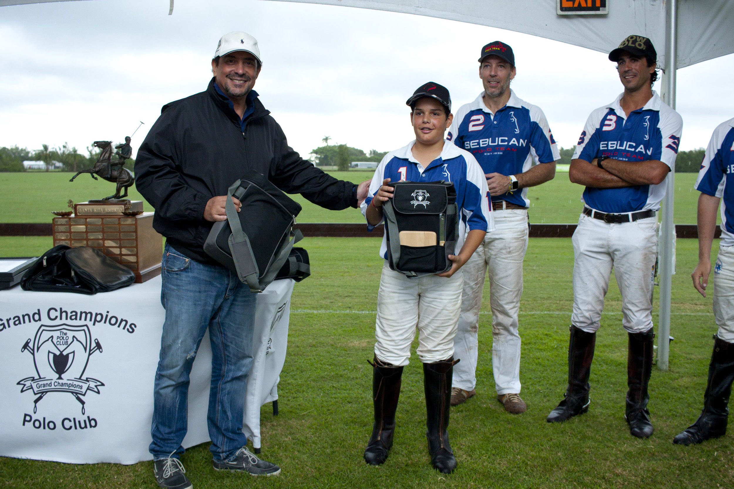 Josh Dubarry of Sebucan receiving his polo sw.JPG