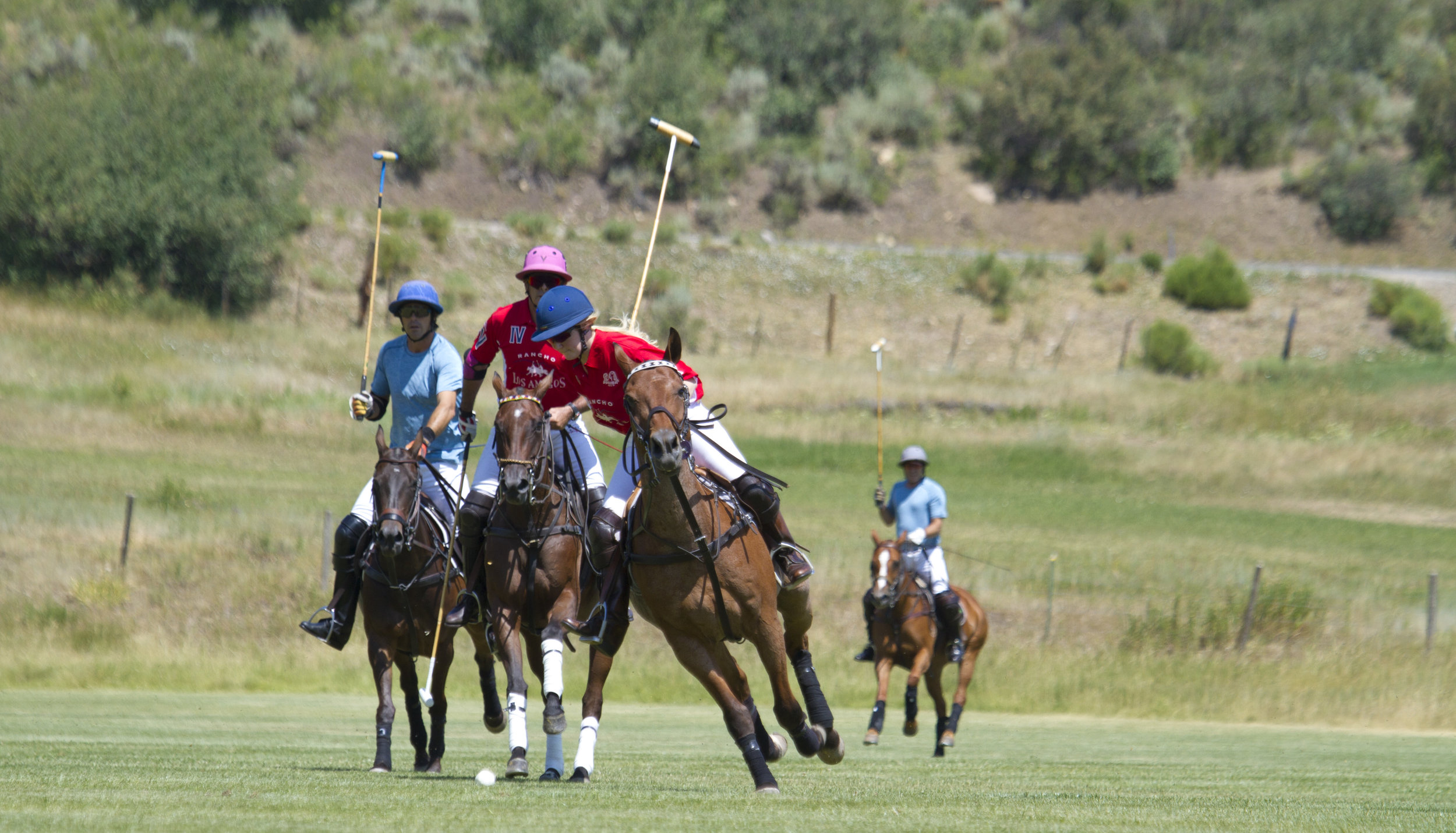 Riley Ganzi of Los Amigos Red drives downfield for her fifth chukker goal.