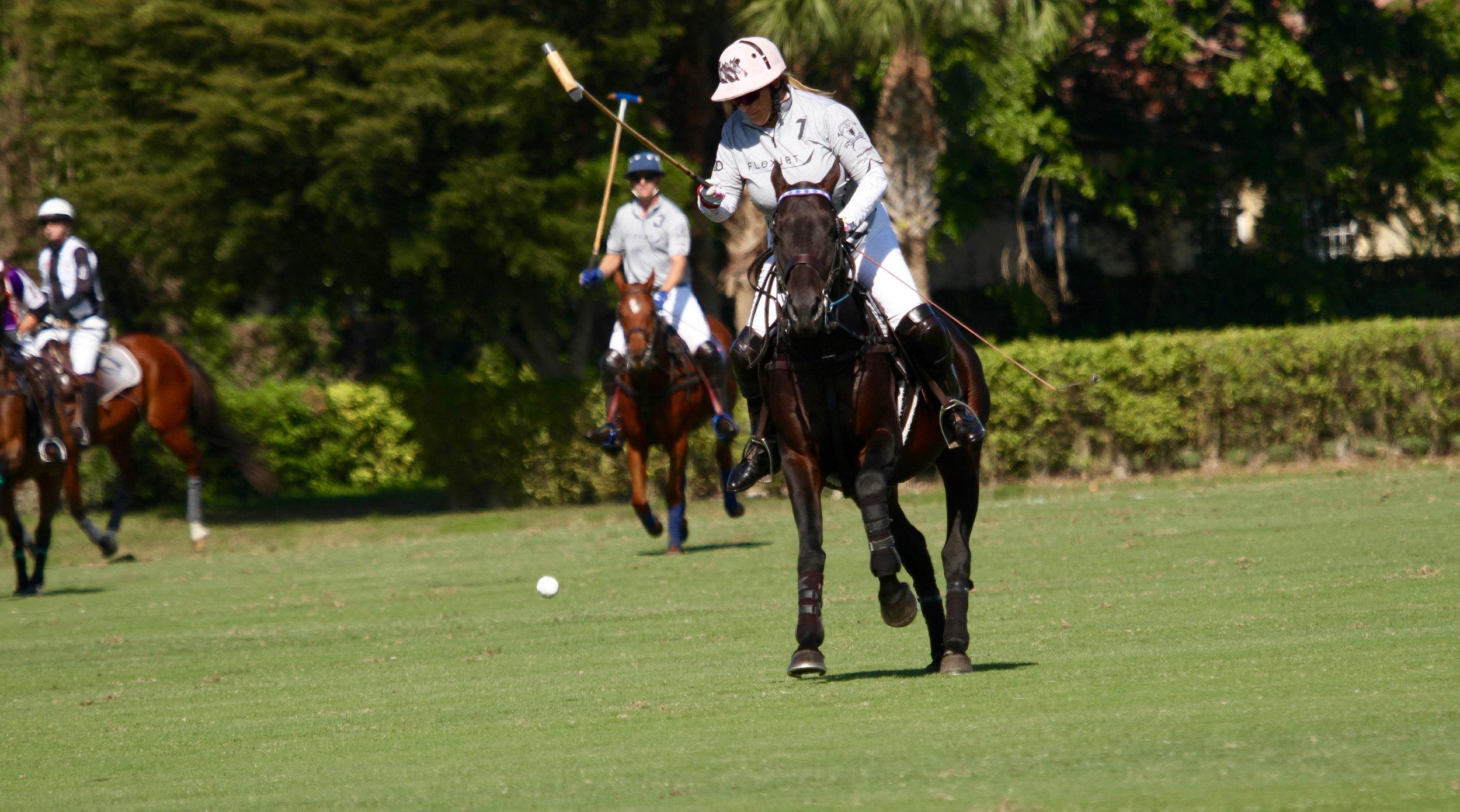 Melissa Ganzi of Flexjet works the ball to g.jpg