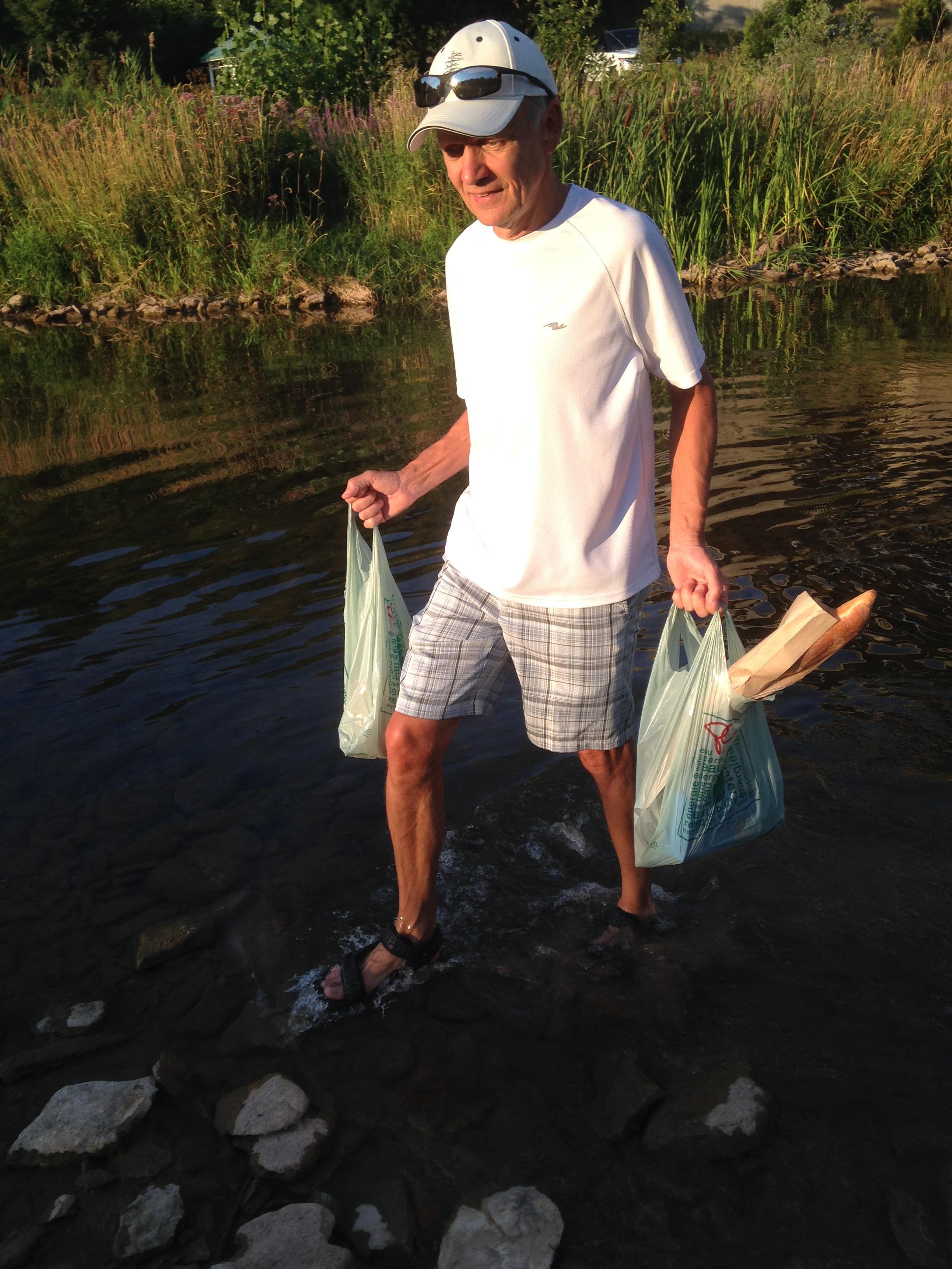 Bob in 16 Mile Creek with groceries in hand