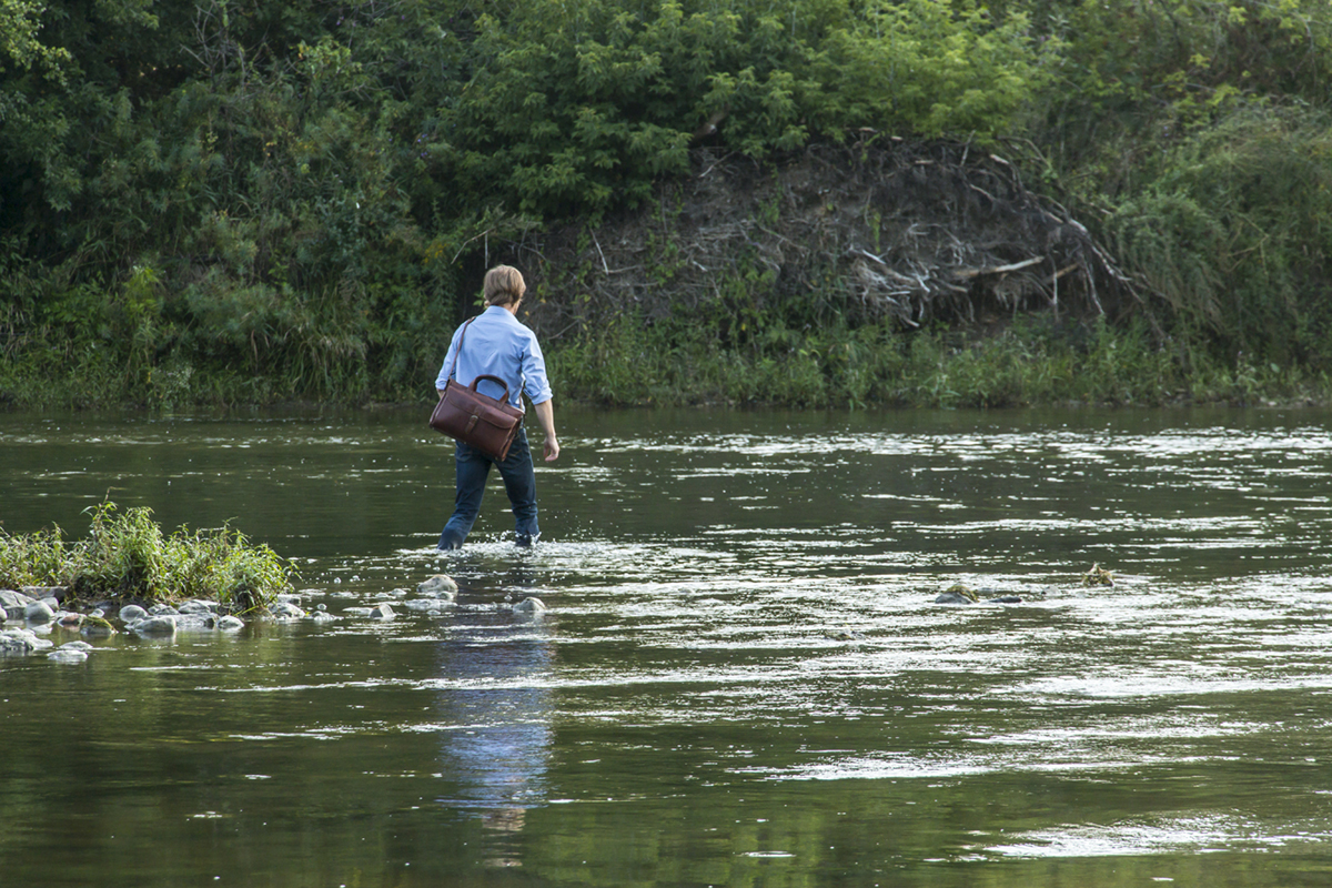 Matthew stepping into the Grand River.