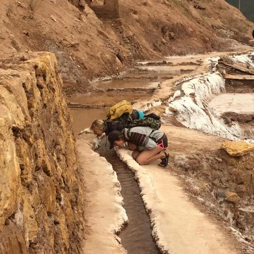 Goofing around and licking the salt mines in Salineras, Peru