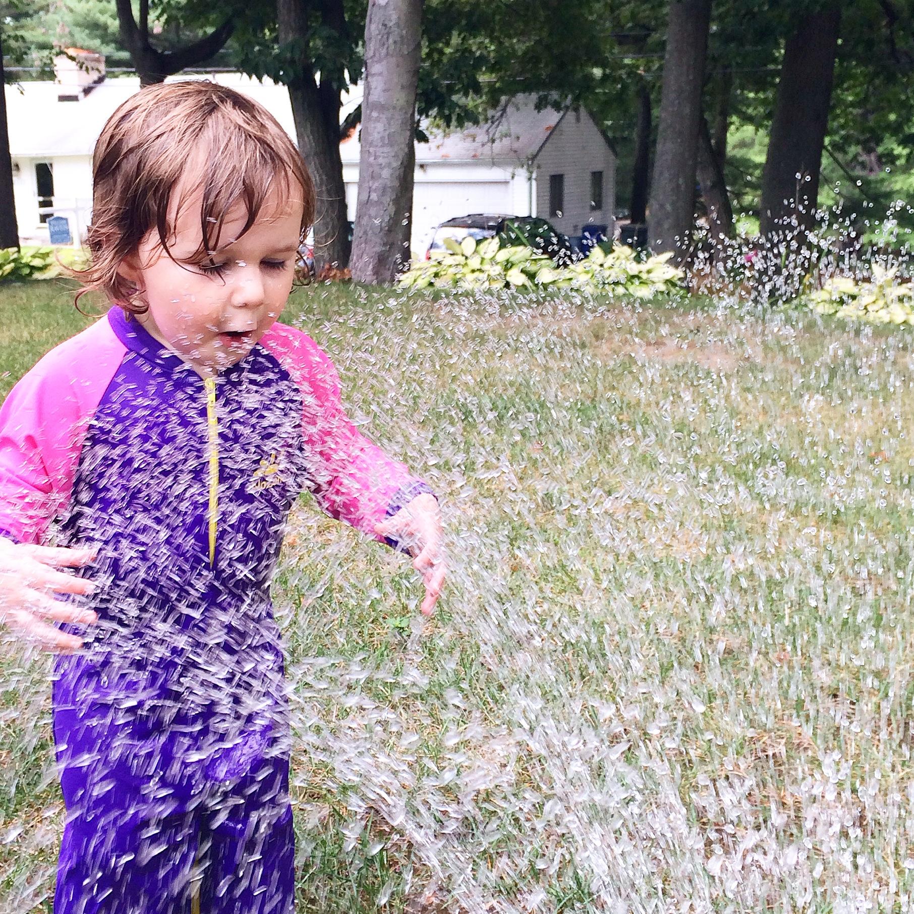 Backyard sprinkler fun taken with iPhone
