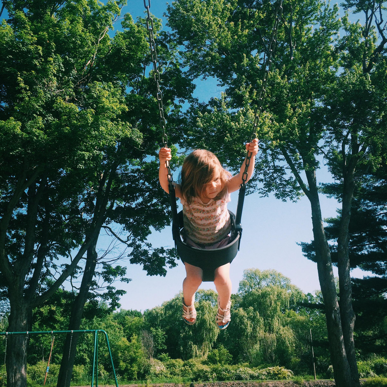 Flying high on the neighborhood playground swings.
