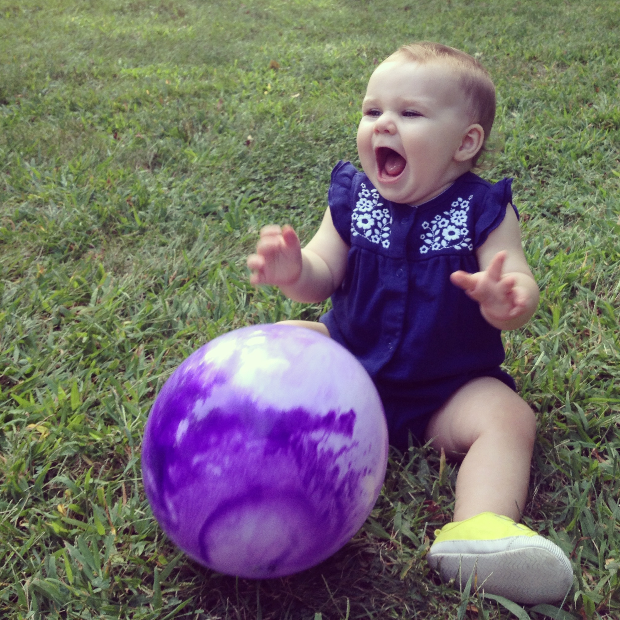 Playing ball at the park (and a few minutes later she took her first steps)!