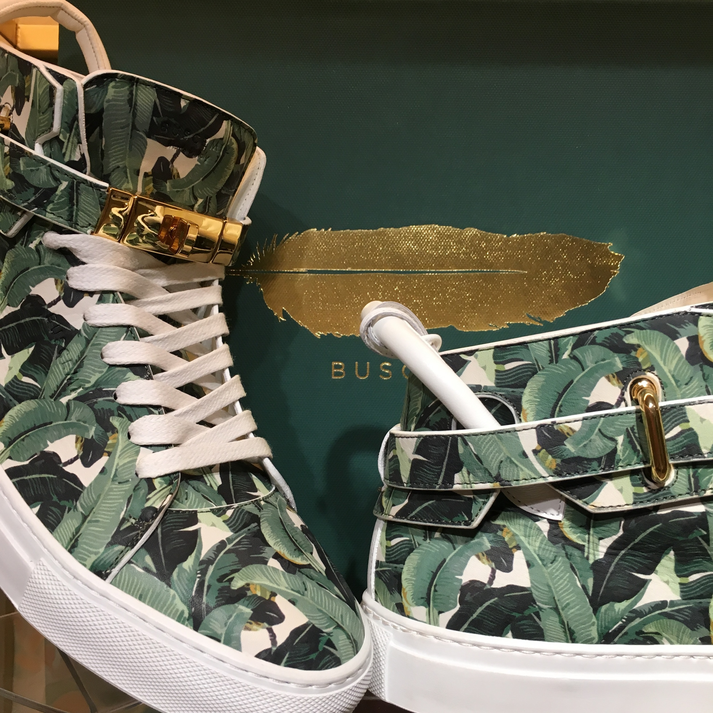 the iconic banana leaf motif on these custom sneakers, Available the GIFT SHOP, $1,100