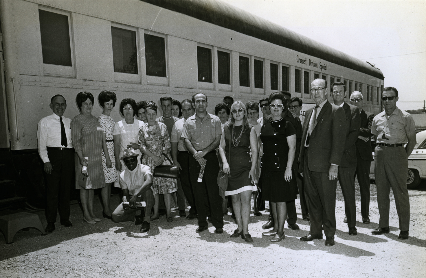 An image of Ross & Wallace Paper Products, Inc. staff on a rail journey to a paper mill.  Circa 1974