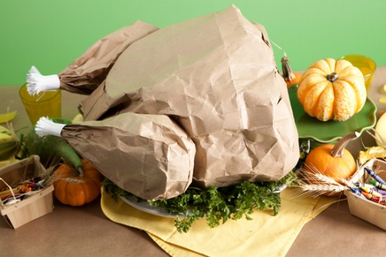 http://onecharmingparty.com/2010/11/02/the-kids-table-paper-bag-turkey/