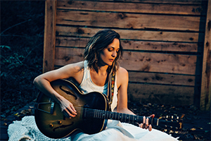 "Amber Rubarth has performed her music far and wide, touring solo across South Africa, Europe, Japan, and America with her ""unique gift of knocking down walls with songs so strong they sound like classics from another era."" -Acoustic Guitar Magazine. She stars alongside Joe Purdy in the award-winning film 'American Folk' which will be screened at the Hoot!"