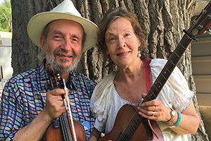 "Jay Ungar & Molly Mason , have contributed immense vision and hard work to preserving Ashokan and it's music and nature programs. From organizing big-picture development to playing "" Home Grown Tomatoes "" and "" Ashokan Farewell "" for visiting 5th graders nearly every week, their leadership and love of Ashokan has helped to preserve the land and ""safe place to try new things"" for thousands of adults and children to experience each year."