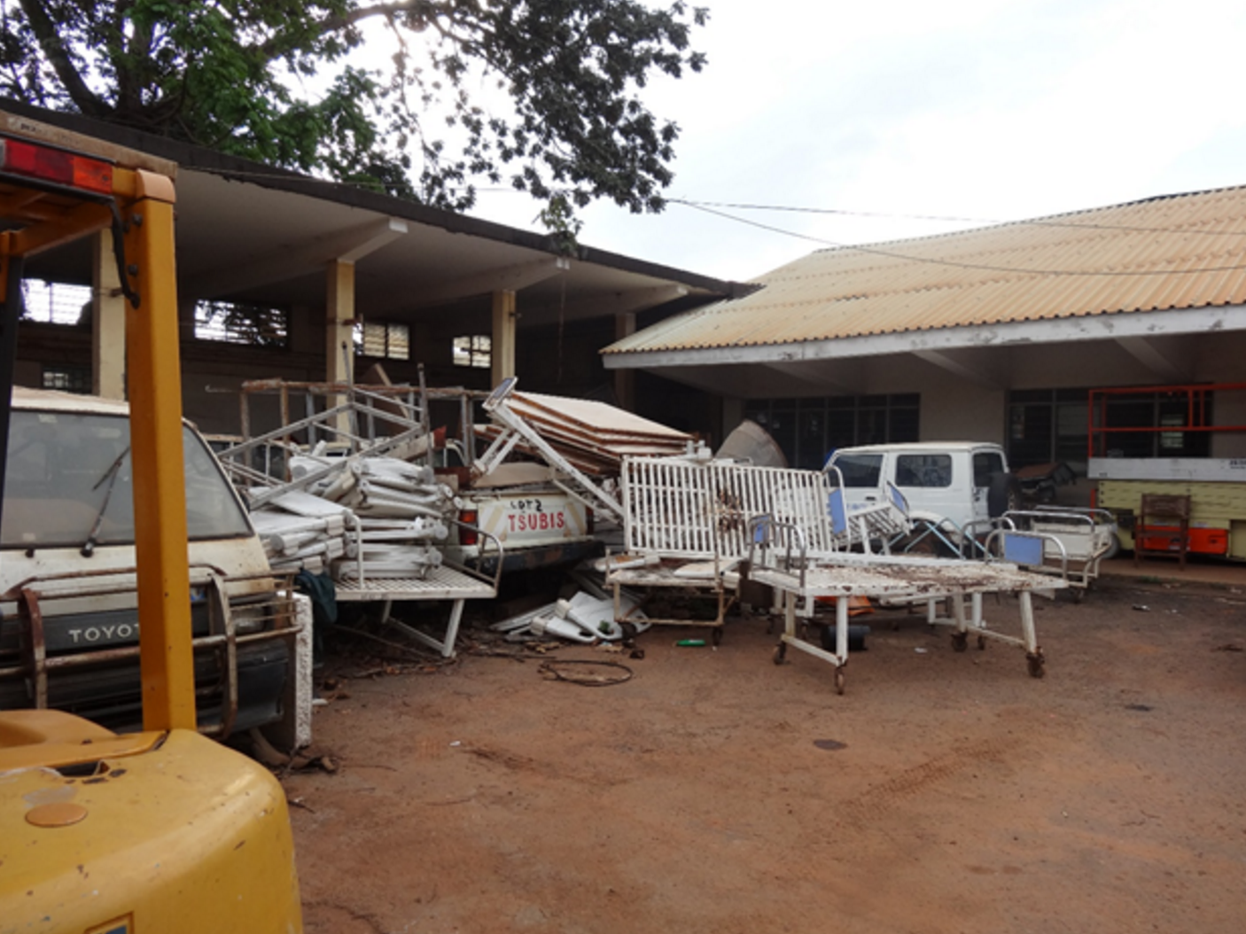 At Mulago Hospital, the 'Medical Device Graveyard' is where old medical equipment goes to die. Many broken devices have been out of service for many years, but remain (sardonically) affixed with prominent notes that read 'NEEDS FIXING'.    Photo by Arbutus Medical