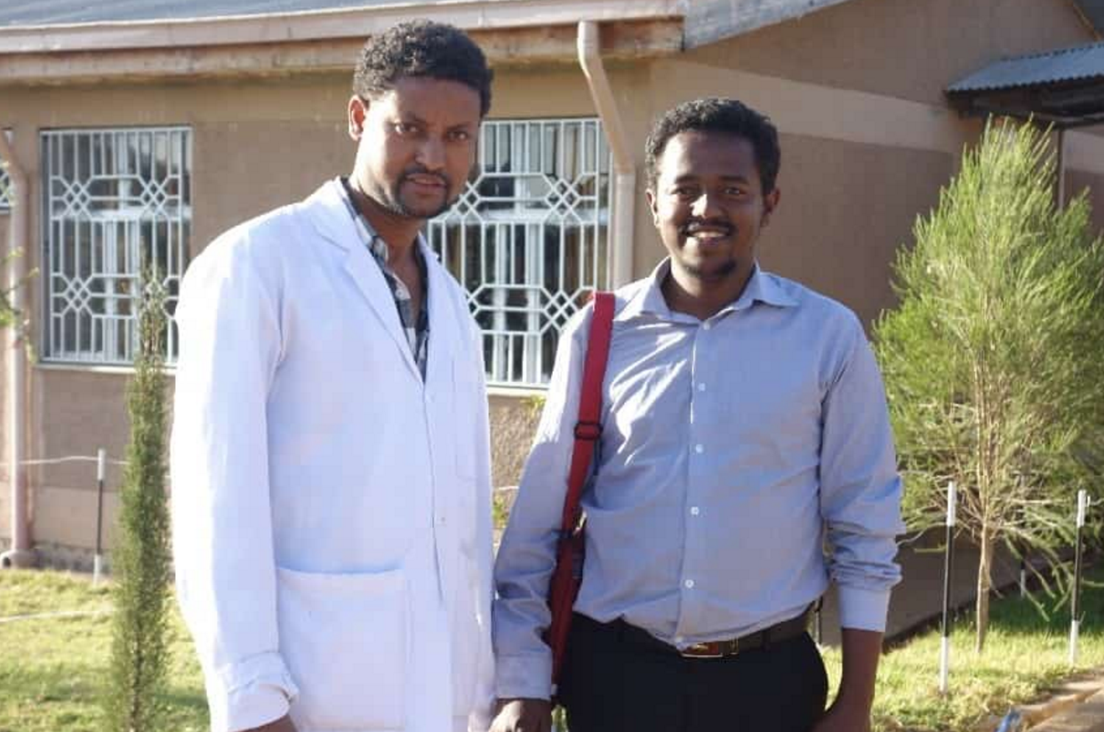 Emergency clinical officer Amsalu Tiruneh (left) and Dr. Zebenay Bitew are part of a team-approach to improving surgical services .