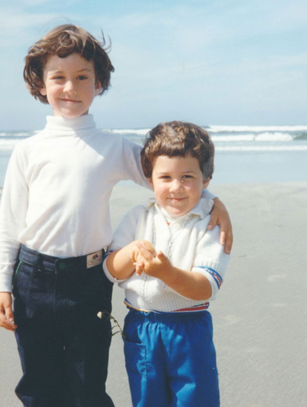 A picture of my big sister and I on the wild and wavy shores of Cox Bay, Tofino, B.C.