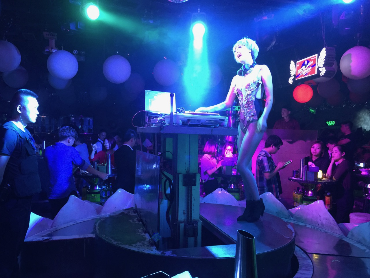 Female DJ dressed provocatively at Phebe 3D. The DJs call the shots in this club.