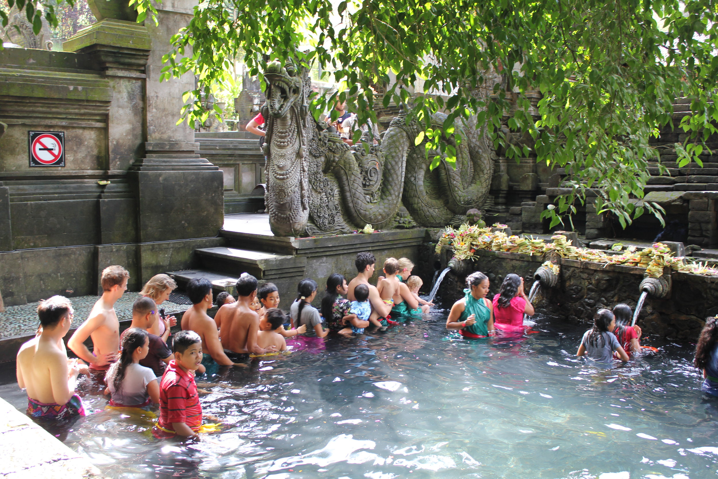 People from all parts of the world bathe in the holy waters of Tirta Empul in Bali, one of the most beautiful temples I've been to in Asia
