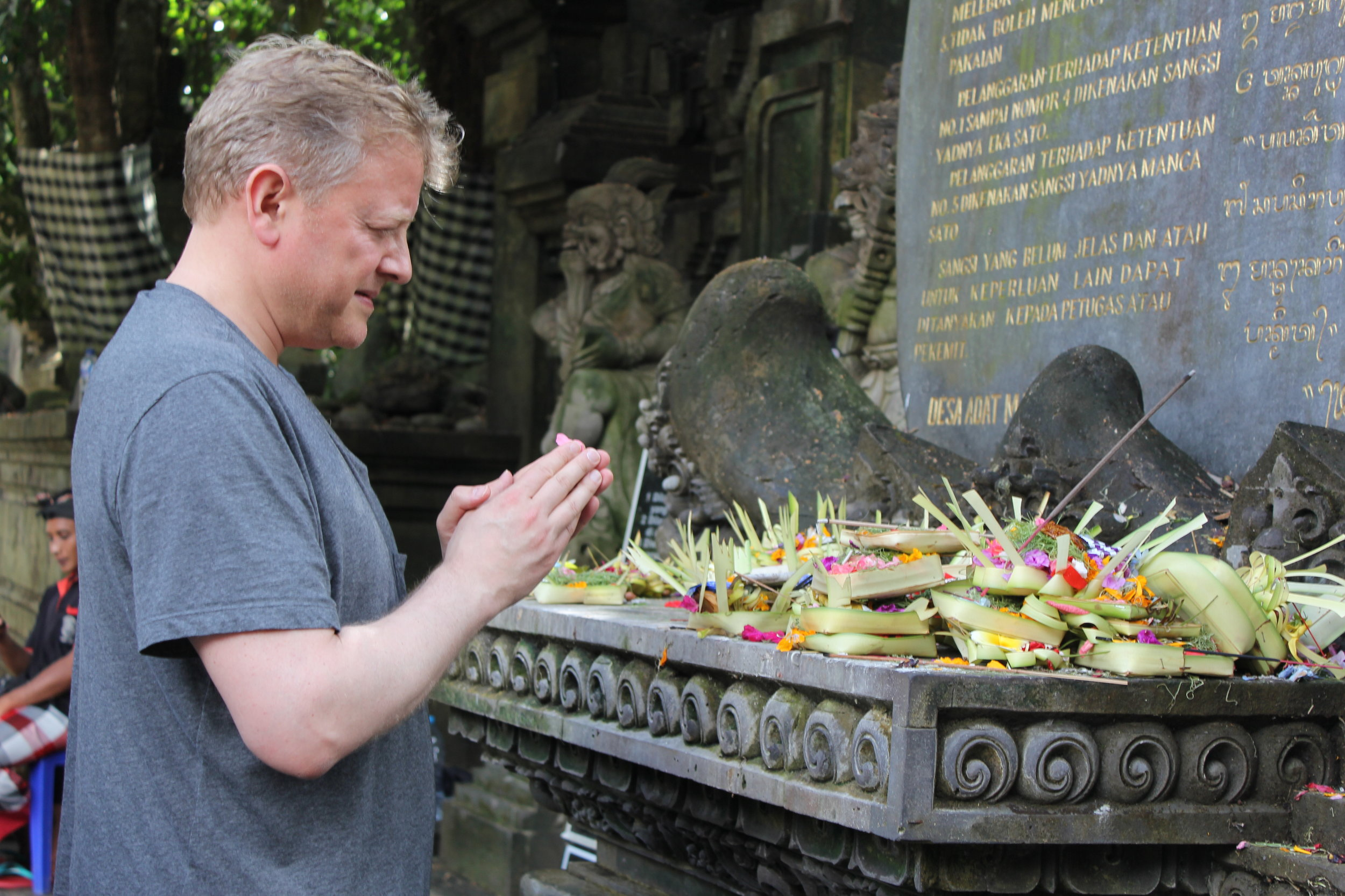 Saying a prayer for family at Tirta Empul, and yes I bathed there too.