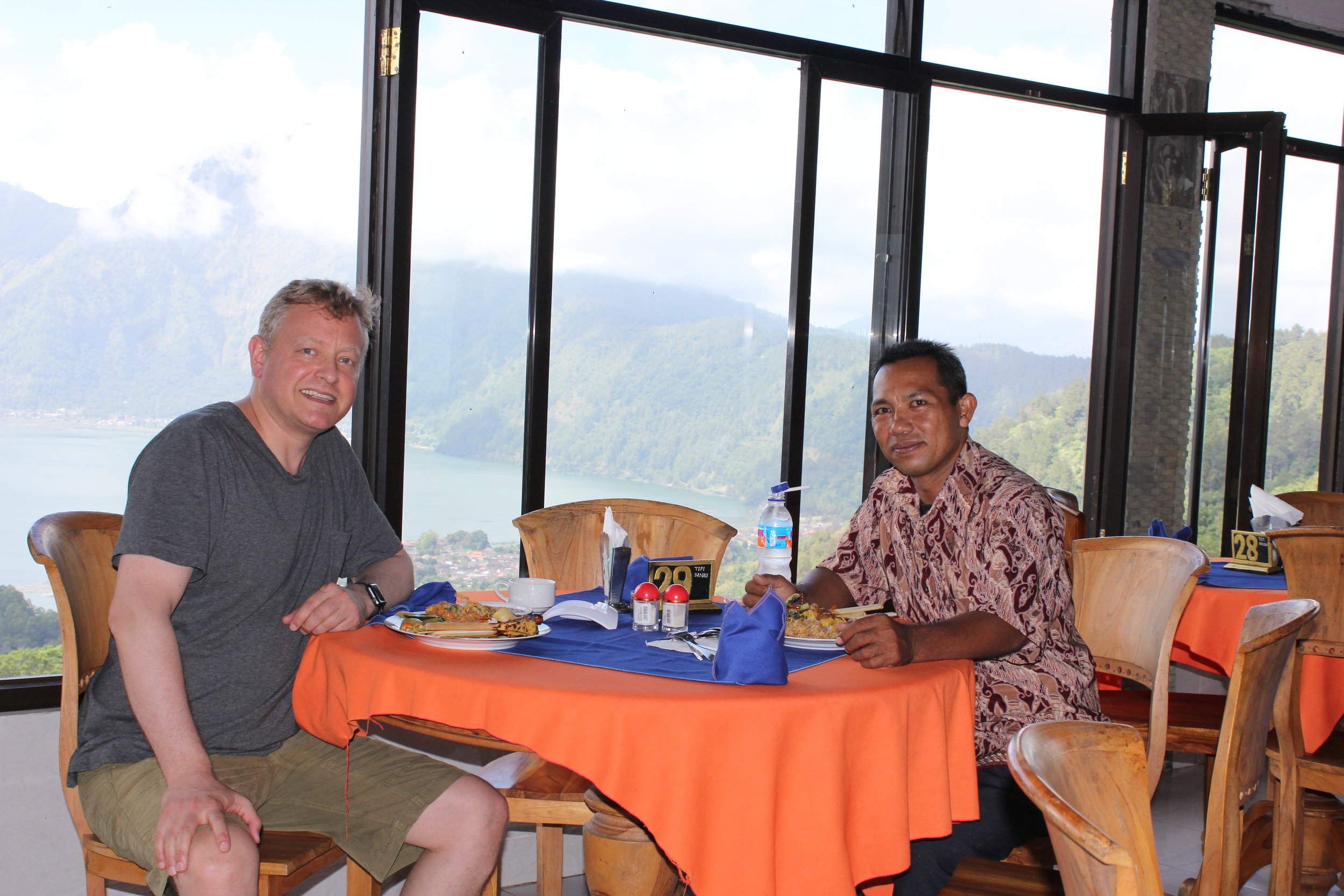Me and my guide Sudirma at a restaurant overlooking Batur Lake