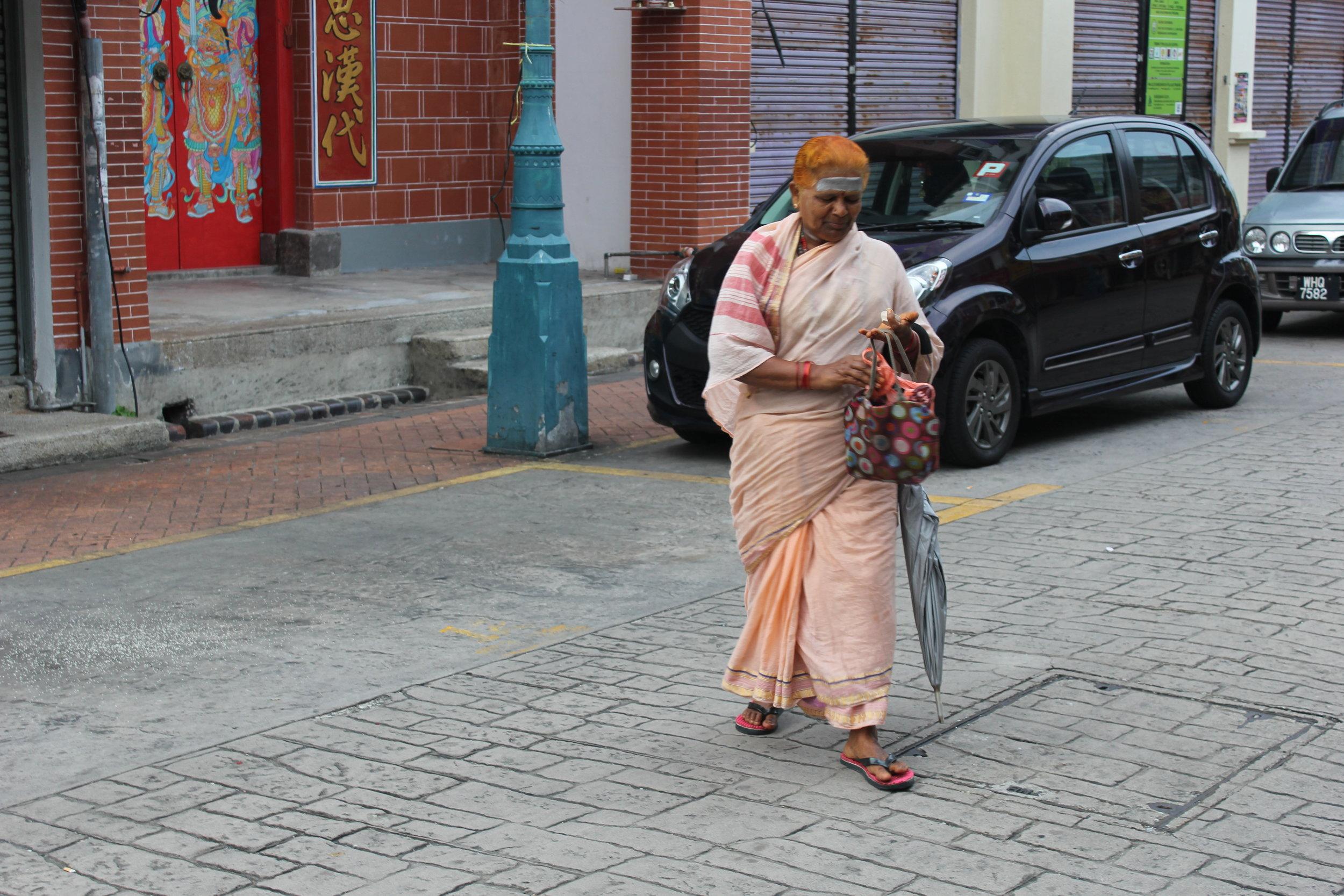 A woman walking in George Town's India Town on Penang Island, Malaysia