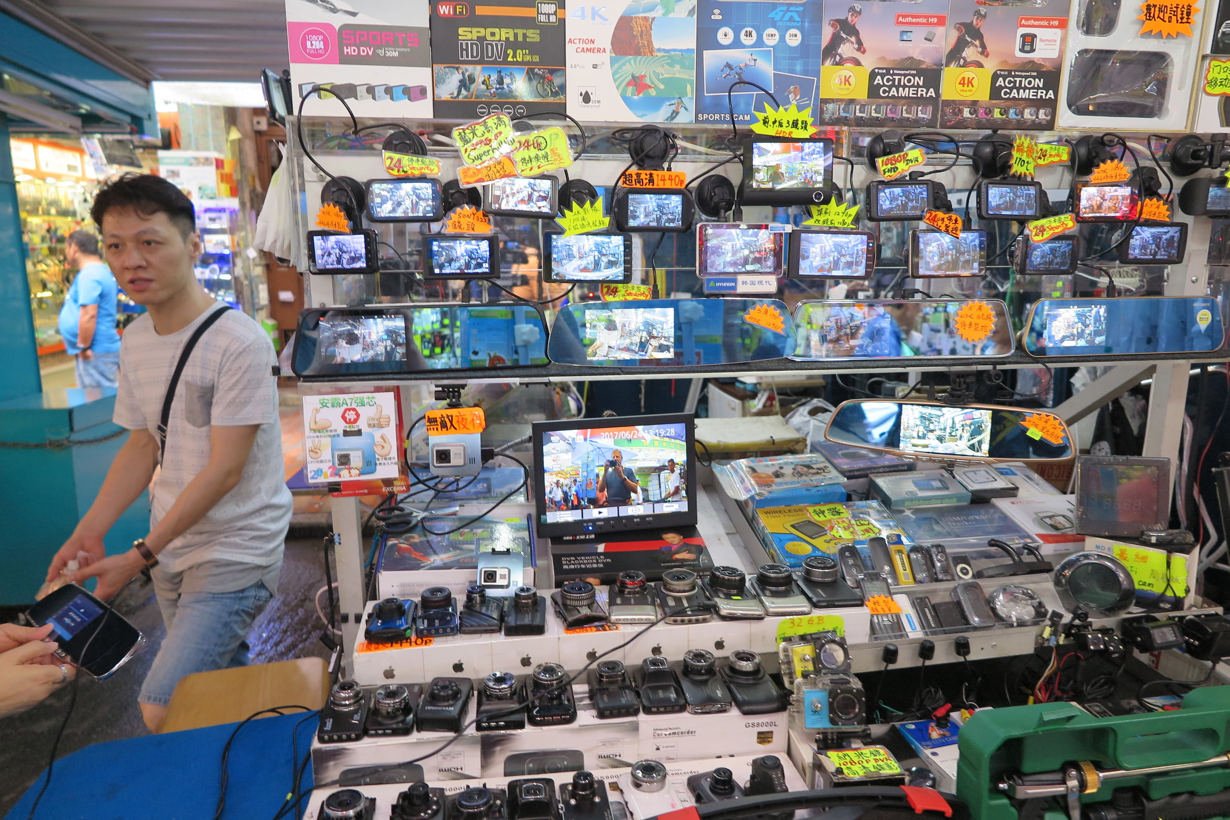 one of hundreds of electronics stalls in the street markets of Sham Shui Po in Kowloon