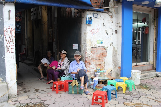 Folks in Hanoi like to hang out and eat meals in the shade of the alleyways. Small plastic stools come in very handy for the purpose.