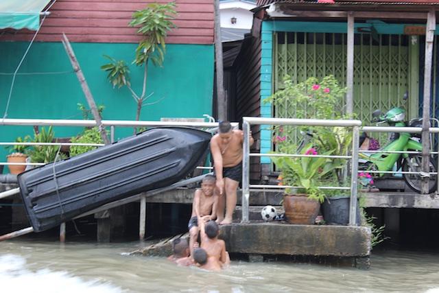 Thai boys enjoying a swim in the canal