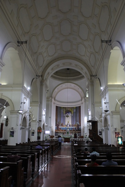 Quiet prayer inside the Cathedral of the Sacred Heart in Delhi