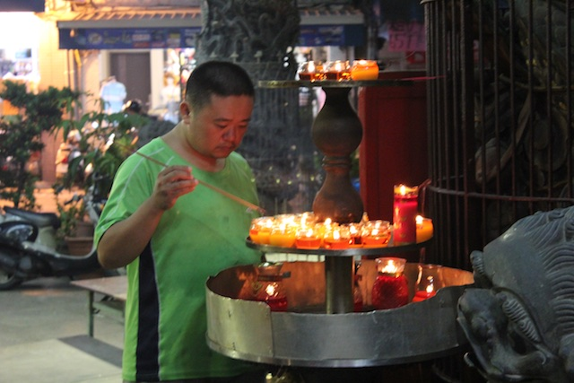 Lighting incense at the Dong Ning Gong temple in Hsinchu