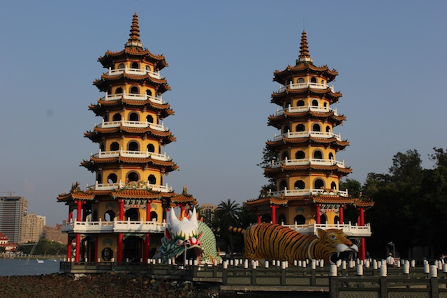 A pair of twin pagodas at Lotus Pond, featuring a dragon-tiger tunnel