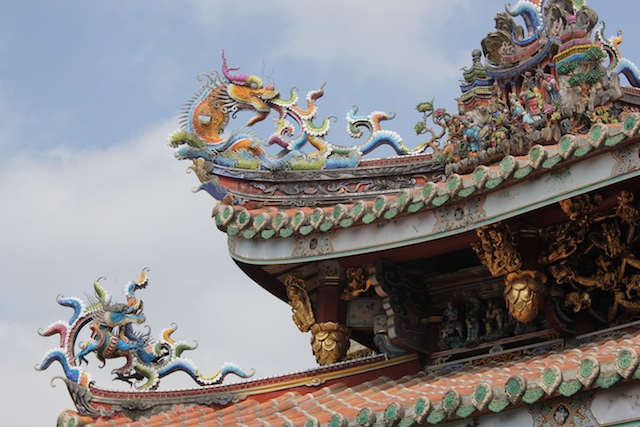 Dragons and other creatures decorate the eaves of the Bao An Gong temple