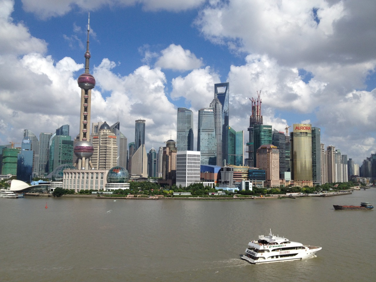 Ok, so I've resurrected a photo I shot a few years ago of a scene looking over the Huangpu River toward the Pudong skyline, which you'd expect to see when somebody writes about Shanghai. Notice that the Shanghai Tower, which now dominates the skyline, was then still under construction. Changes and vicissitudes.