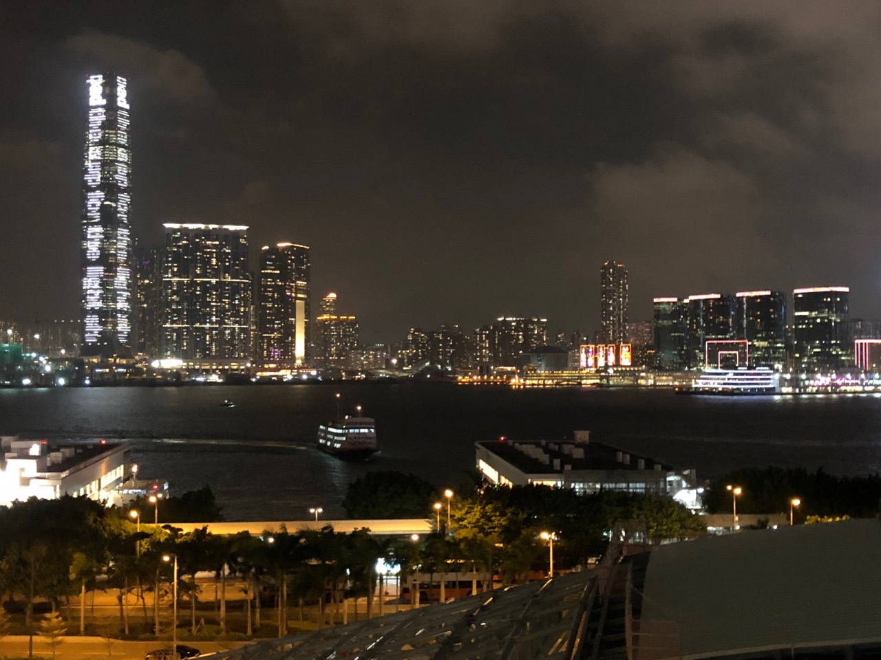 The view from atop the IFC Mall of Hong Kong's Bladerunneresque nightscape, looking out towards Kowloon side
