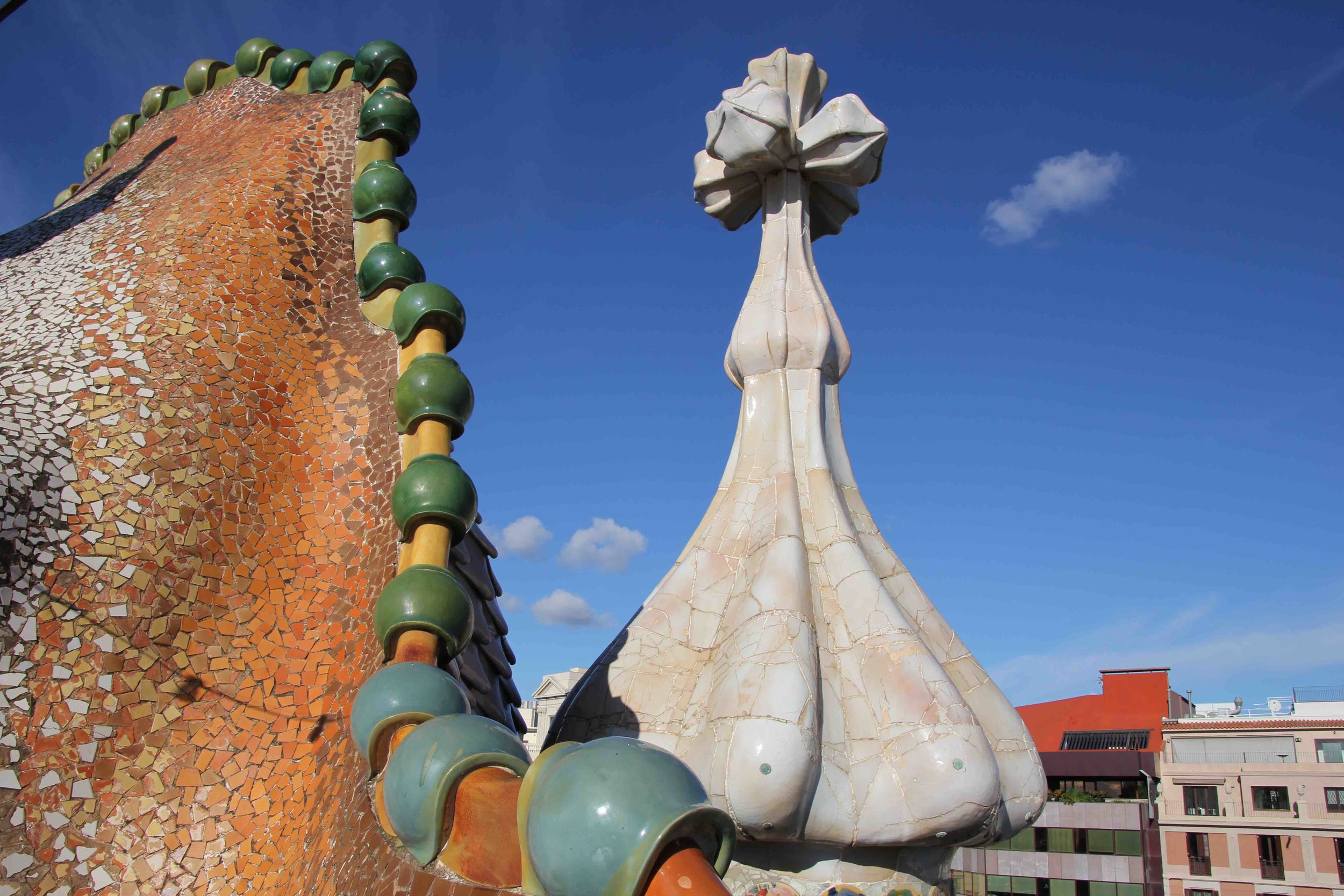 The hilt of St. Jordi's sword plunged into the dragon's back on the rooftop of Casa Battlo