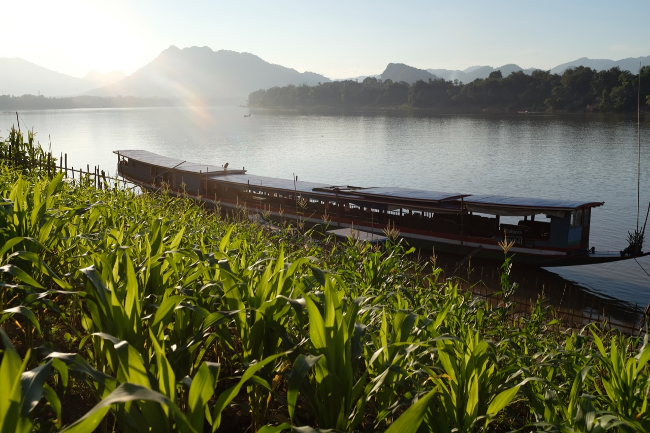 A boat moored on the edge of the Mekong River, near where the Rustic Pathways Base Camp is located.