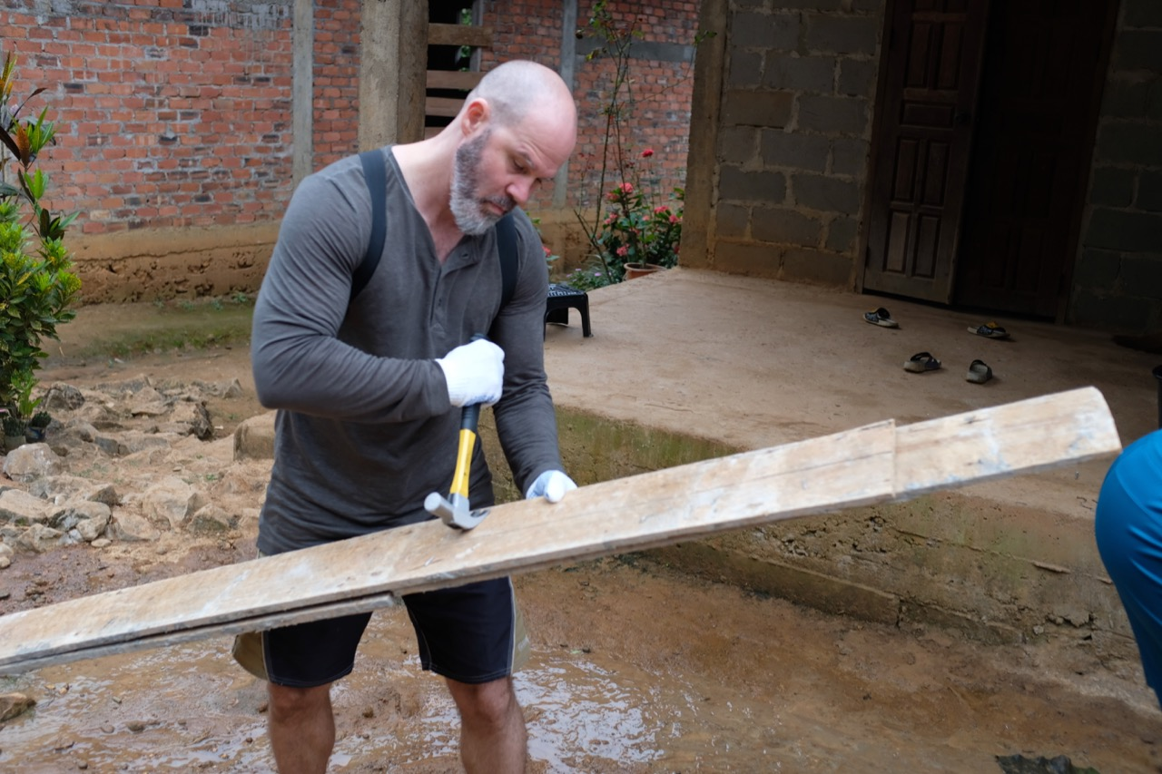 One of the teachers in our group, Dustin, seemed to know what he was doing. Here he applies some carpentry skills to help build foundational posts for a platform that will surround the community center.