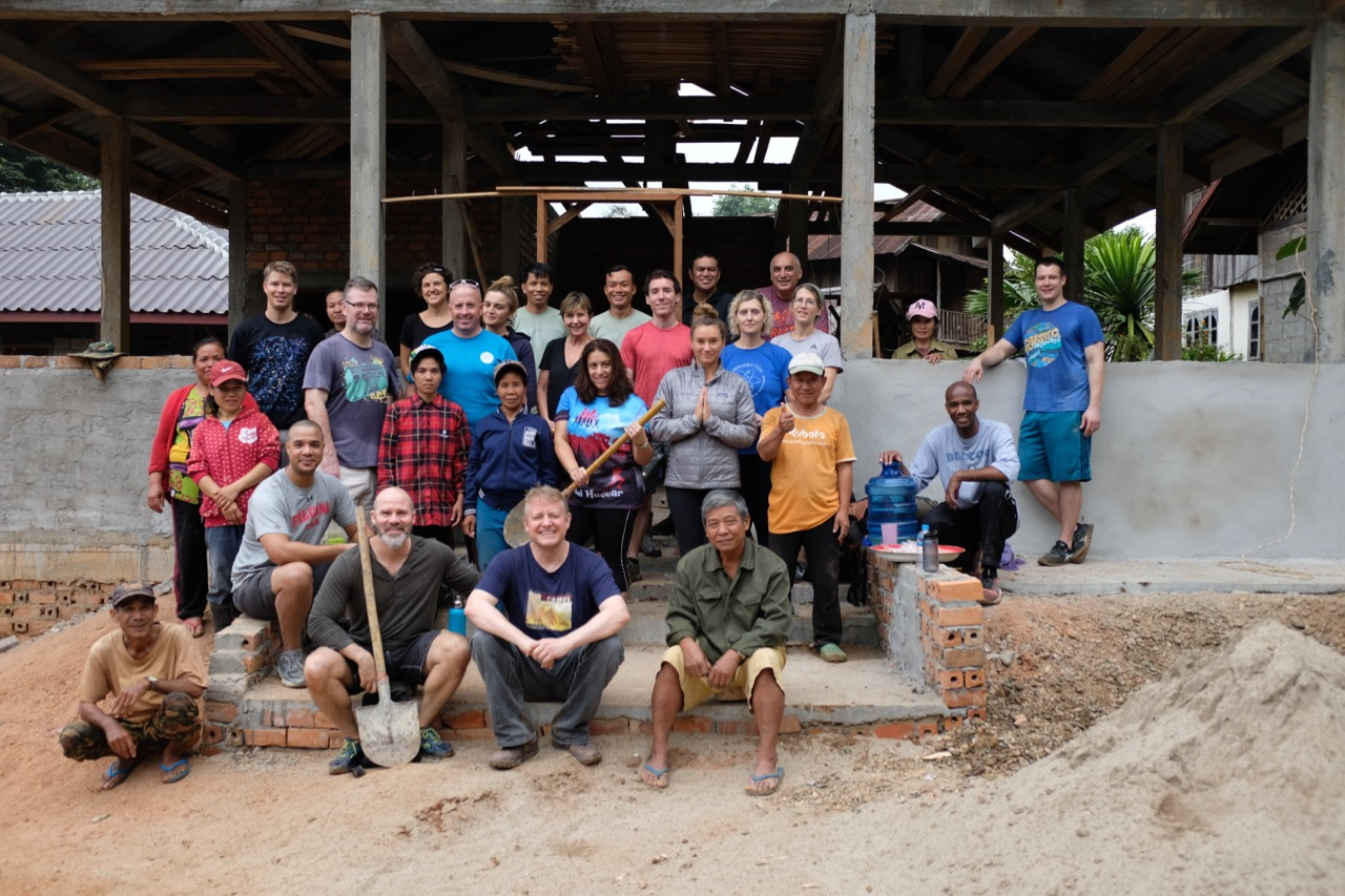 Group photo of the work crew. Behind us is the community center, which will take a while longer to complete. Each group that comes up here makes a modest contribution to it.