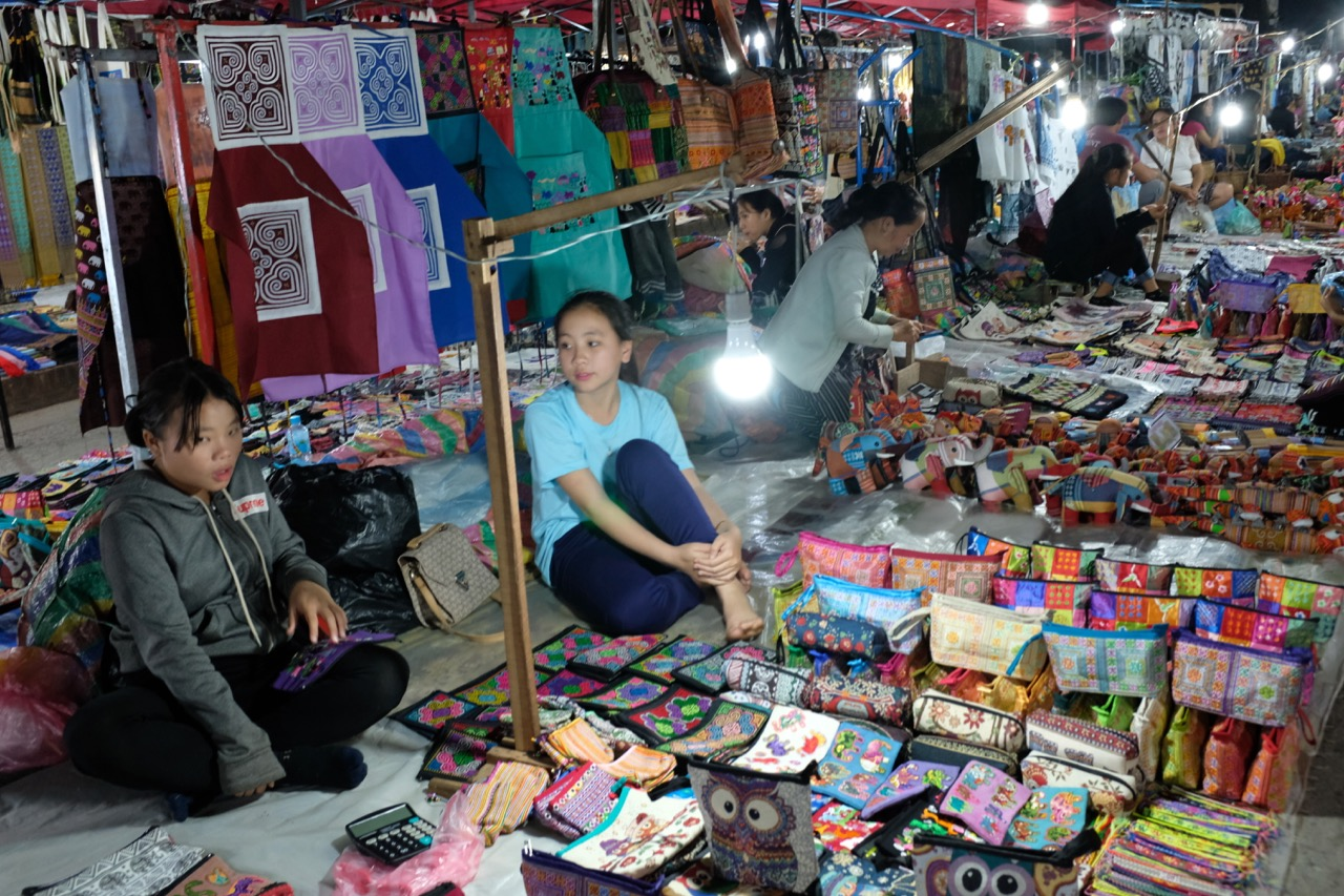 At night the Main Street running through Luang Prabang becomes a big night market featuring stalls like these.