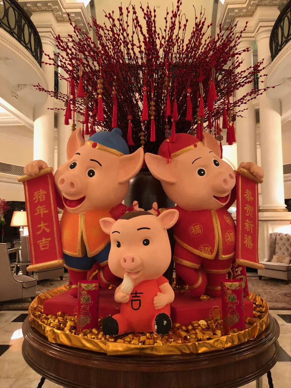 Three little pigs, a New Year display at the Waldorf Astoria on the Bund