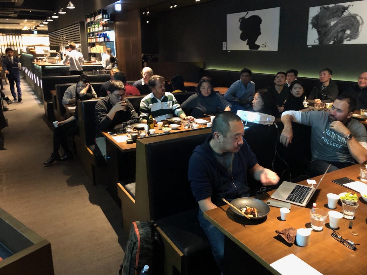 The Dartmouth alums listen to a speech over dinner at Ki Niseko