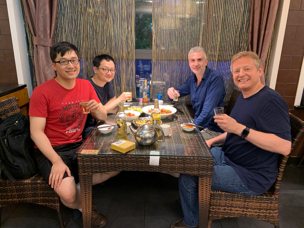 Enjoying a fine Hunanese meal with my co-panelists Renren, Junting, and Cedric