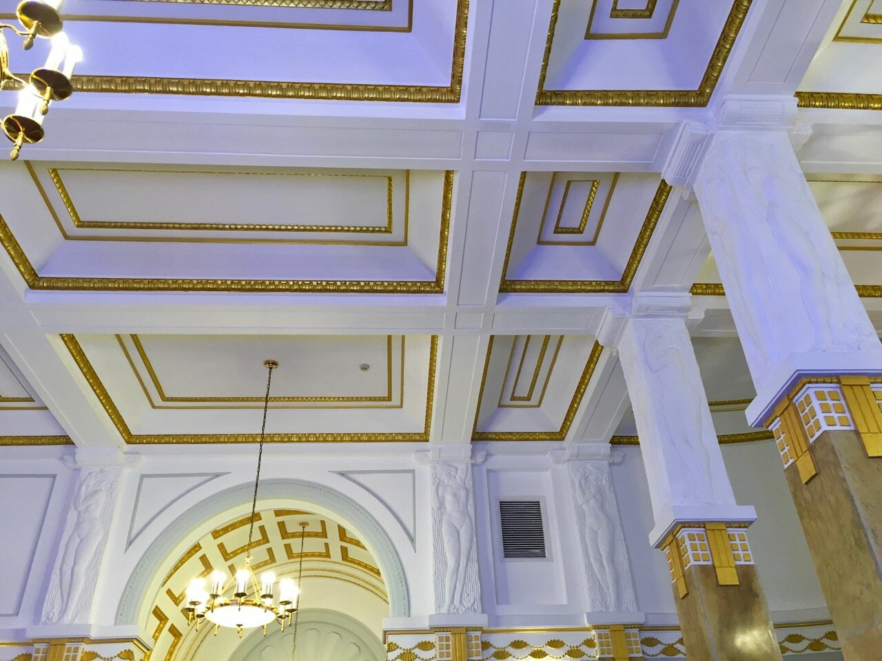 The grand hall leading to the second floor ballroom of the former French Club has kept its original design, including the caryatids (nude female bas relief figures) on the pillars holding up the ceiling.