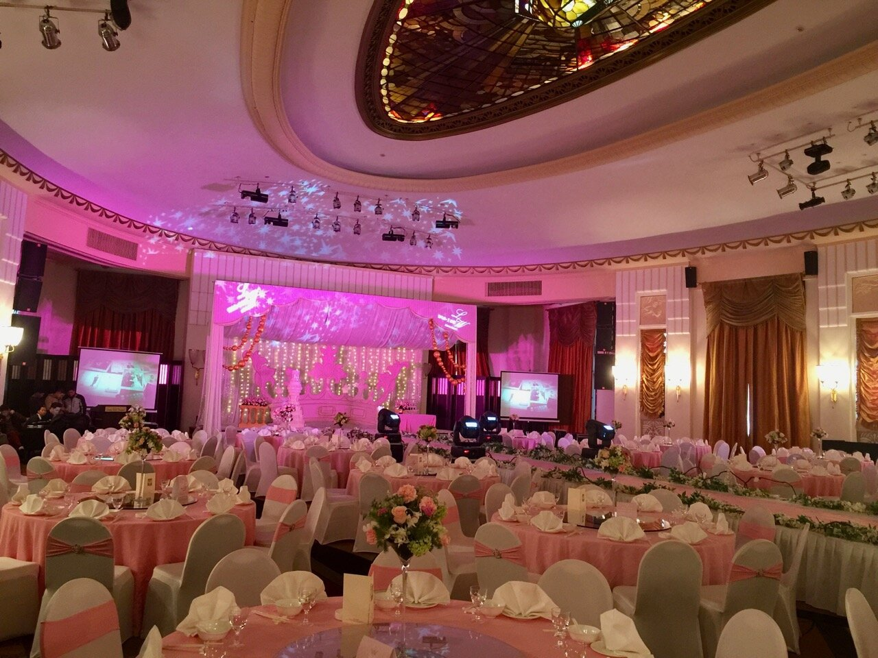 The ballroom is being gussied up for a private wedding party. Unfortunately the original sprung dance floor is hidden by a thick rug.