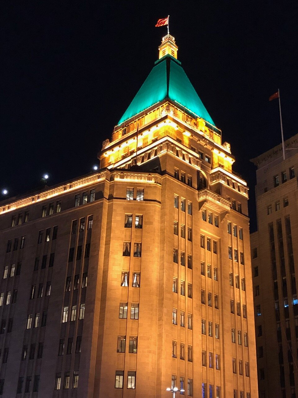 The Peace Hotel with its famous tower as seen from the Bund at night