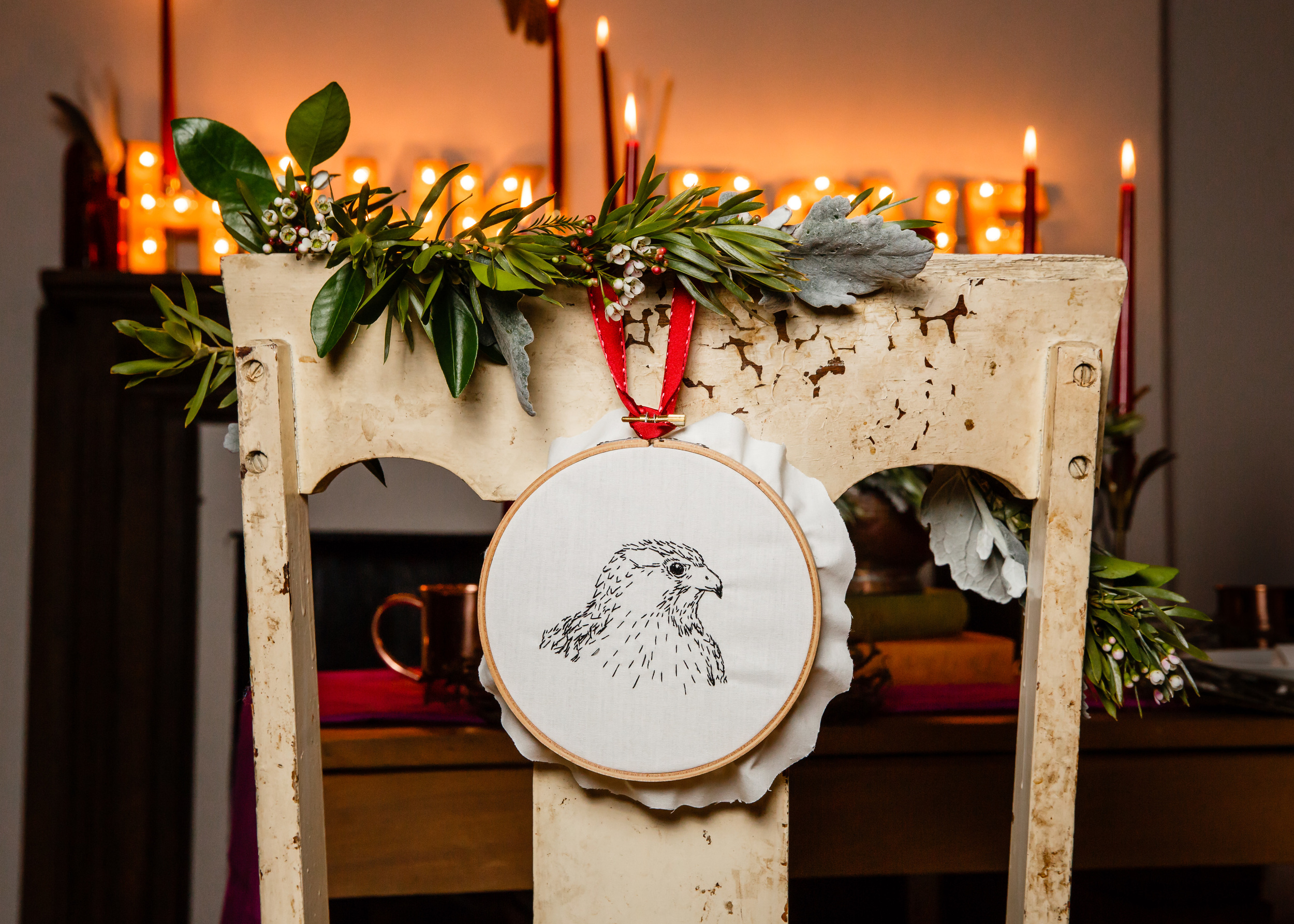 I embroidered these chair back embroideries of a hawk and dove as well. The garland created by Flower Scout really paired well with them.