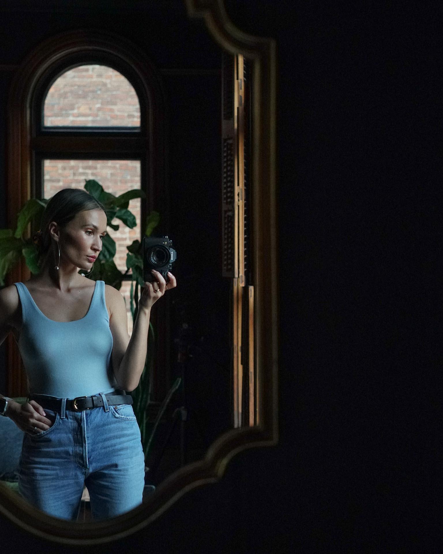 in this photo I'm wearing - earrings Dinosaur Designsbodysuit Aritziabelt H&M jeans AGOLDE