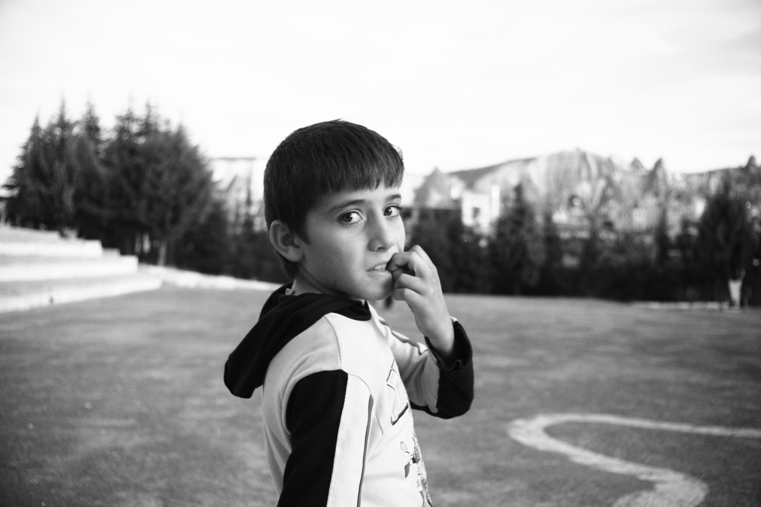 """Millions   """"We had settled in the small town of Goreme in Turkey for awhile, getting to know the people, the culture. I was getting fairly adventurous and decide to walk around the outskirts of the town at dusk to find some photographic opportunities. I came across a group of young boys playing soccer. This boy was one of them. Be careful not to melt in his eyes."""""""