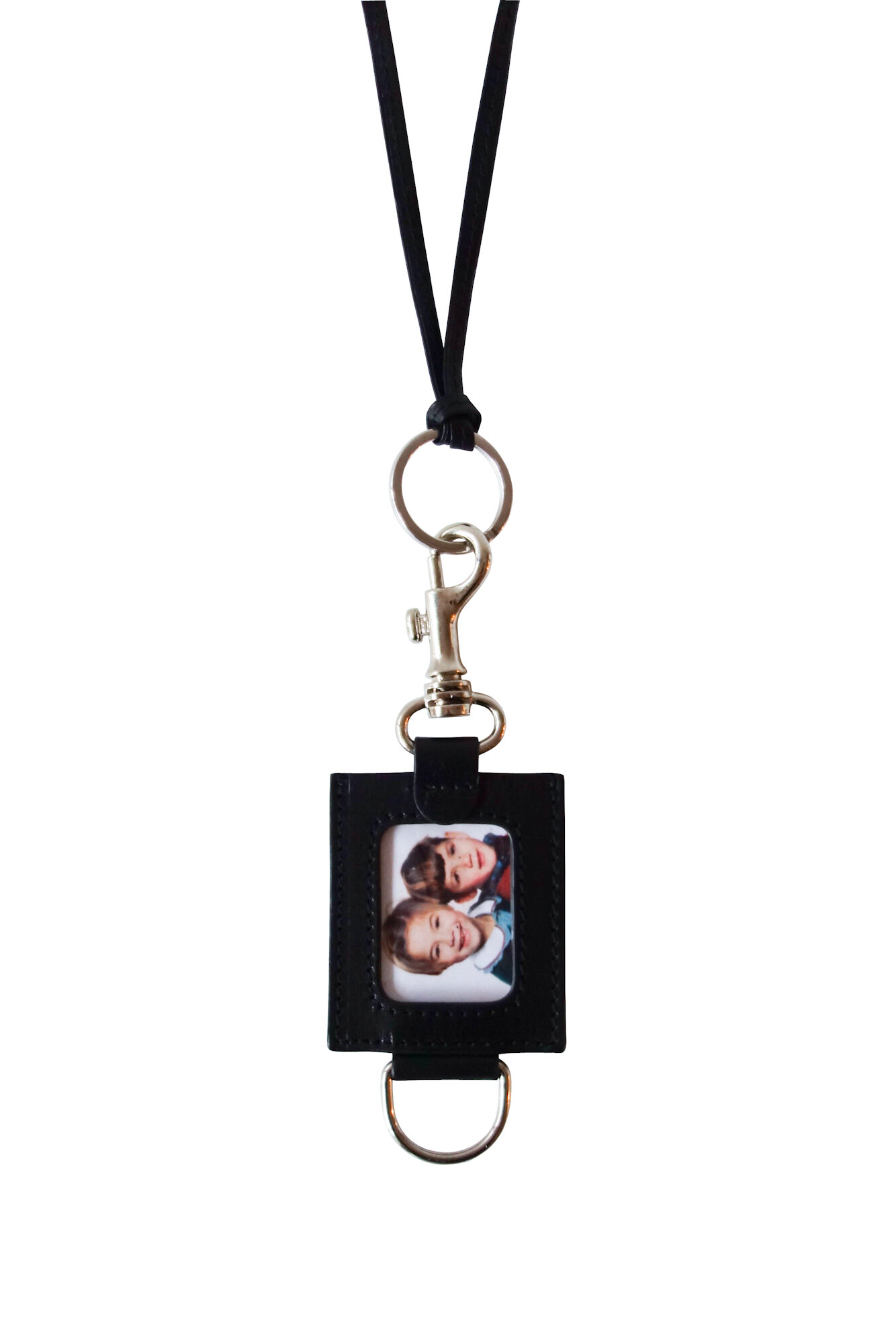 Photo Holder $290 - Can be worn as a necklace or attached to bags, pants etc.Detachable leather neck strap, adjustable lengthCarabiner attachment | D-RingLeather | PVCMade in Italy