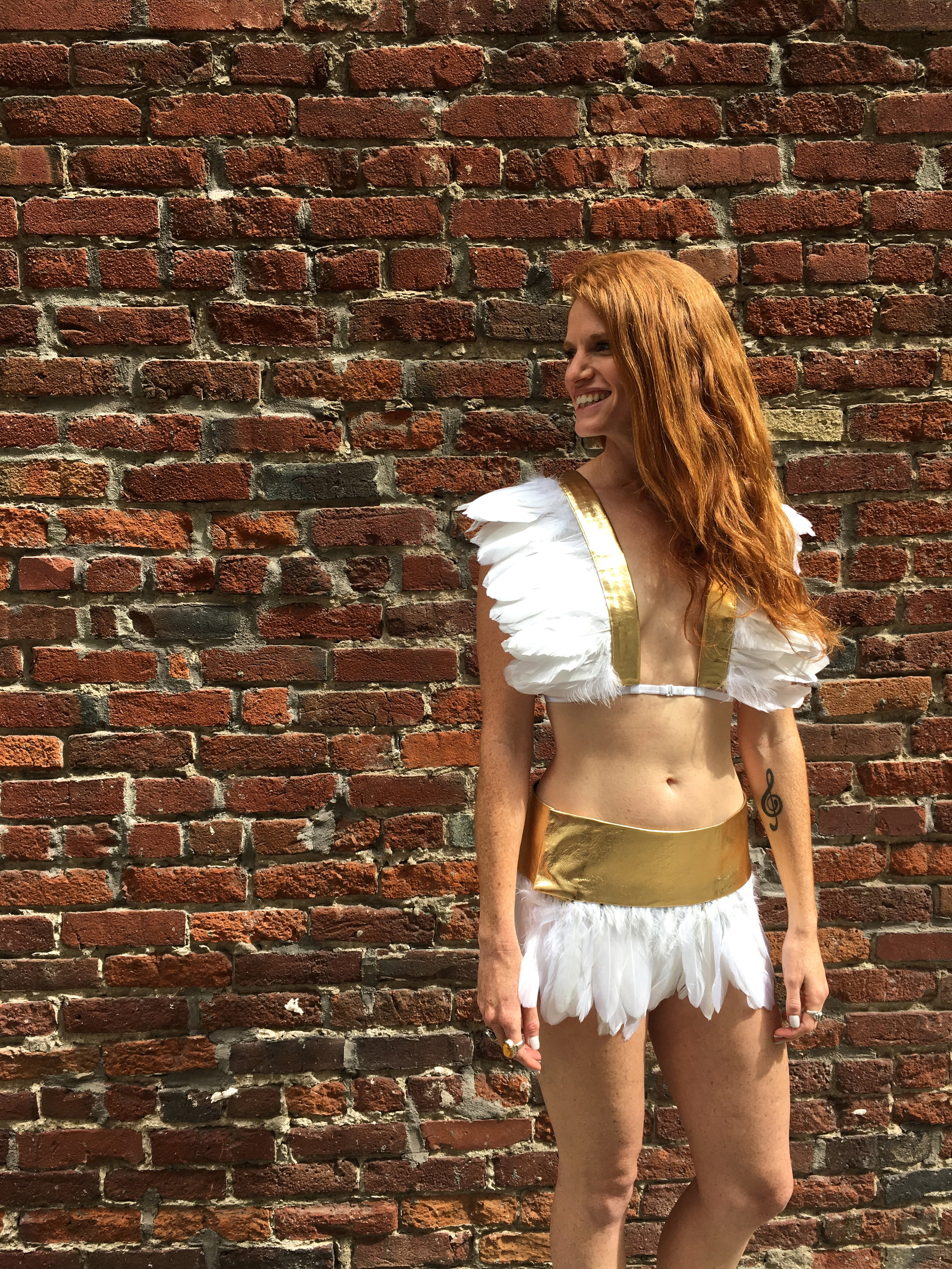 Womens white boho chic Feather top and feather skirt with gold leather details, festival outfits perfect for burning man