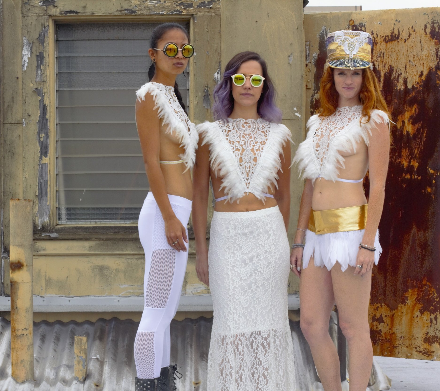Womens all white boho chic Feather tops and feather skirts, festival outfits perfect for burning man