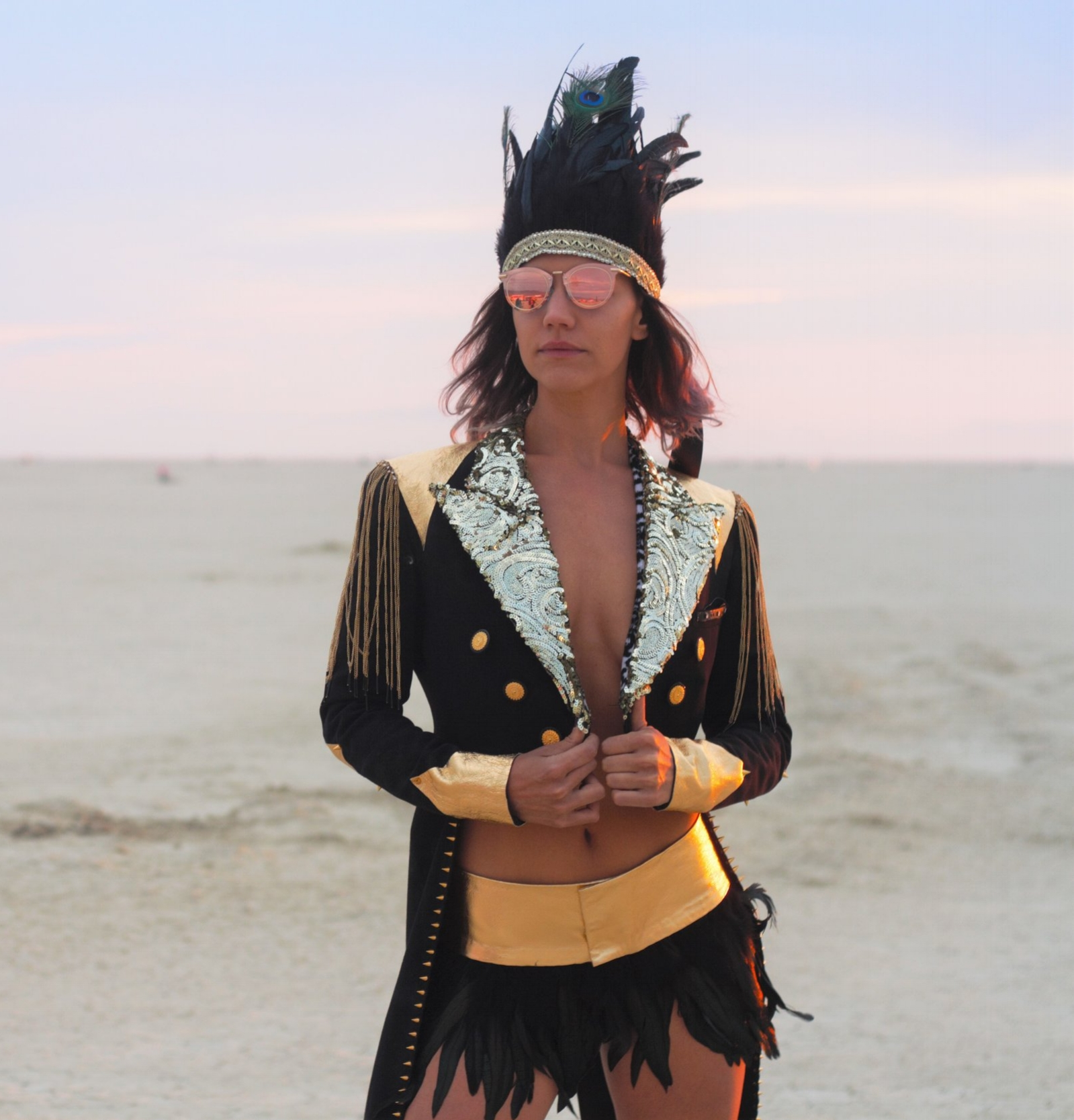 black and gold sequin jacket, black feather headdress and gold leather rave skirt