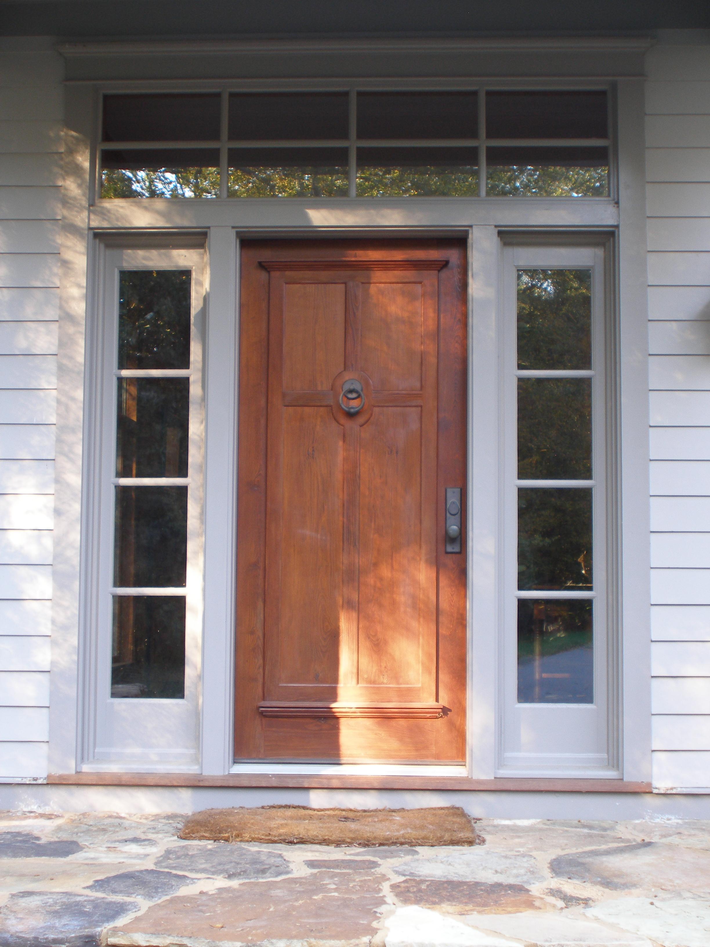 Double panelled heart pine front door.